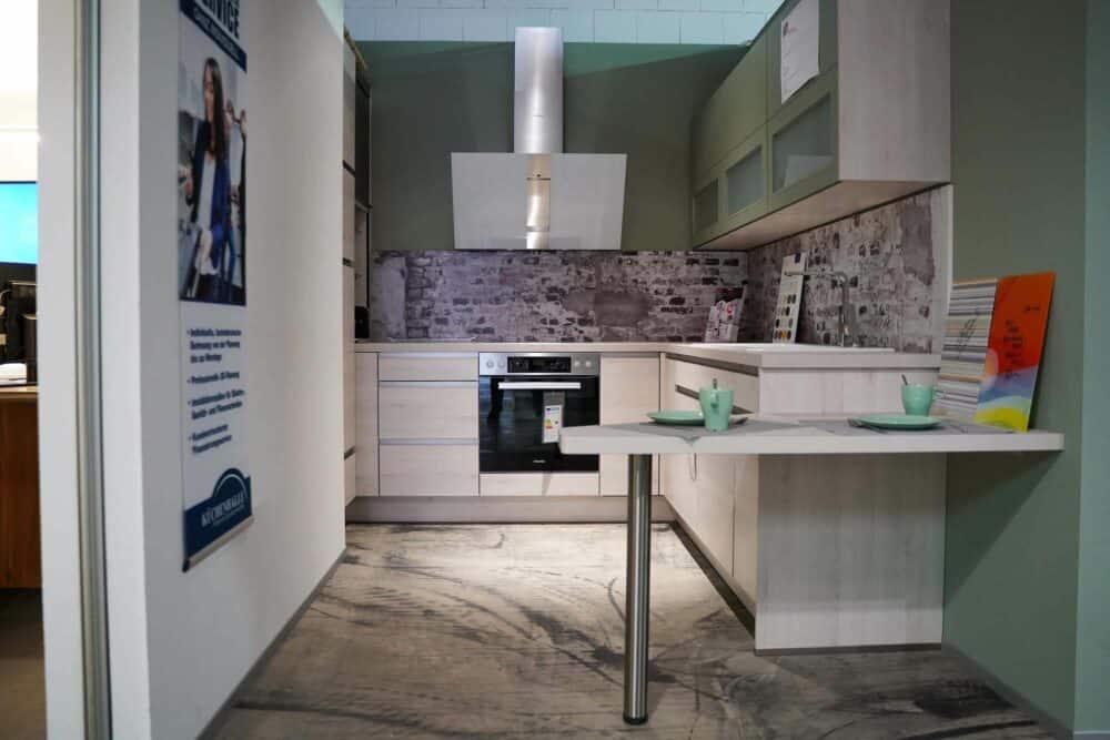 Design L-Küche grifflos grün